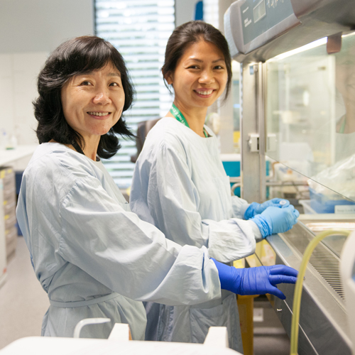 Two professionals in laboratory smiling